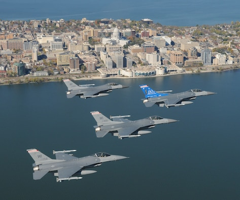 A four ship of F-16C Fighting Falcons from the 115th Fighter Wing, Wisconsin Air National Guard over Wisconsin's capital city of Madison October 18th, 2008.  In flight lead is aircraft 87-278 with a unique tail flash that was designed to celebrate the unit's 60th Anniversary.  (U.S. Air Force Photo by Master Sgt. Paul Gorman)  (RELEASED)