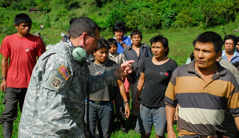 Army Staff Sgt. Colon, Joint Task Force-Bravo, translates instructions to locals in a remote village in Costa Rica. Each village received food, supplies and blankets. (U.S. Air Force photo by Staff Sgt. Joel Mease)