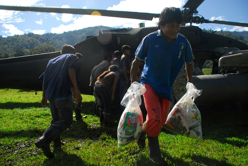 A person from a remote village in Costa Rica carry back food and supplies delivered by Joint Task Force-Bravo Dec. 1. (U.S. Air Force photo by Staff Sgt. Joel Mease)