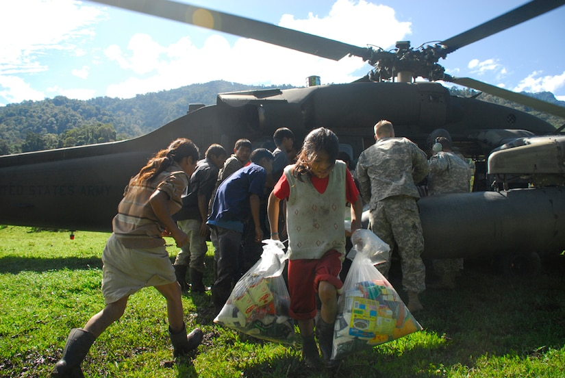 A child from a remote village in Costa Rica carries back food and supplies delivered by Joint Task Force-Bravo Dec. 1. The remote villages are inaccessable by vehicle and can take up to three days by foot to reach. (U.S. Air Force photo by Staff Sgt. Joel Mease)