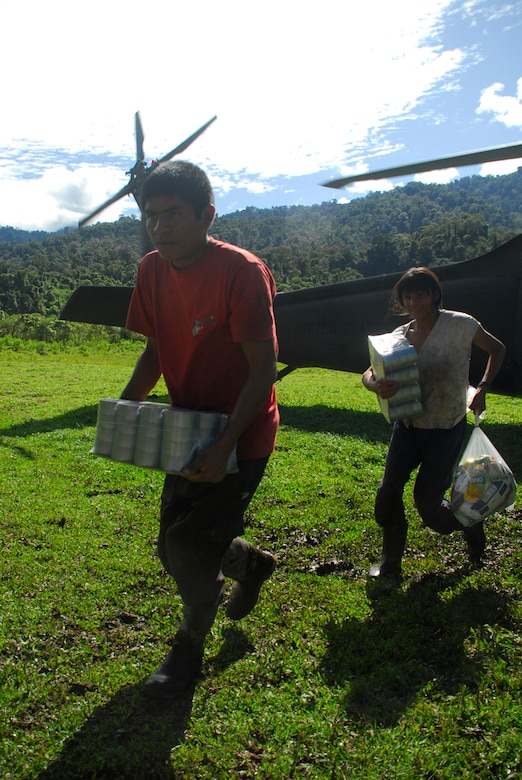 People from a remote village in Costa Rica carry back food and supplies delivered by Joint Task Force-Bravo Dec. 1. More than 150,000 pound had been delivered in Costa Rica and Panama by Nov. 30. (U.S. Air Force photo by Staff Sgt. Joel Mease)
