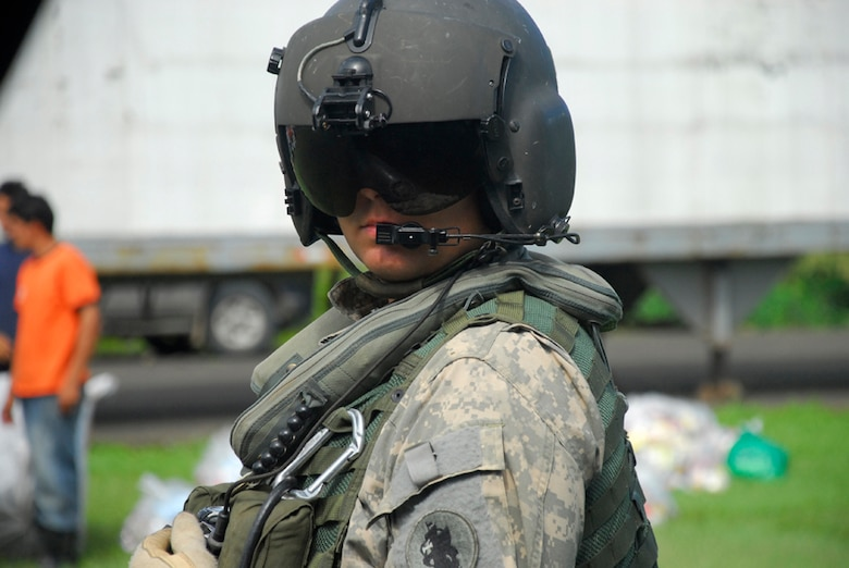 Army Sgt. Chris Jackson, Joint Task Force-Bravo crew chief, awaits instructions on the location of the next food drop Dec. 1.