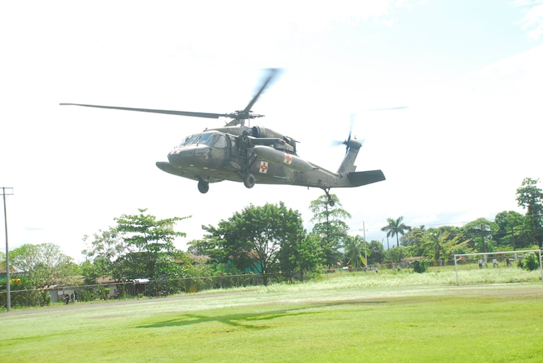 A Blackhawk helicopter from Joint Task Force-Bravo lands Dec. 1 at a food staging point near Puerta Limon, Costa Rica. Blackhawk crews would receive the cargo and then deliver the food to remote areas unaccessable by vehicle. (U.S. Air Force photo by Staff Sgt. Joel Mease)