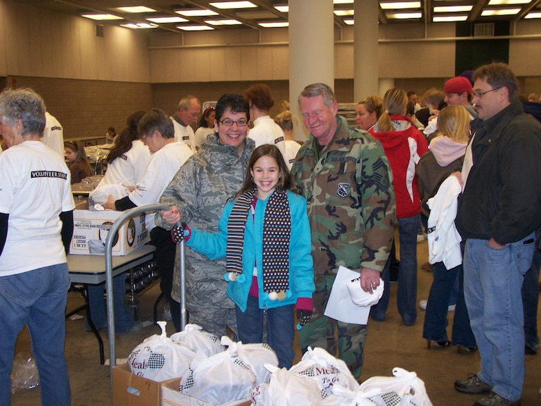 U.S. Air Force Senior Master Sgt. Shelly West and Chief Master Sgt. Jeff West, both 148th Fighter Wing members, along with their daughter volunteer to make deliveries of Thanksgiving meals Nov. 27, 2008 to local community members in Duluth, Minn.  The College of St. Scholastica sponsors a Thanksgiving Buffet for community members each year at the Duluth Entertainment and Convention Center along with home deliveries for people that can not make it to the event.  (U.S. Air Force photo by Capt. Audra Flanagan)