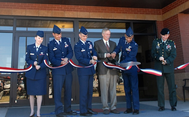 Senior Airman Theresa Davis, 19th Airlift Wing, acting president for the Airman's council, Lt. Col. Jeffrey Collins, 19th Services Squadron commander, Col. C.K. Hyde, 314th Airlift Wing commadner, Congressman Vic Snyder, Col. James Johnson, vice commander 19th Airlift Wing and U.S. Army Col. Donald Jackson Army Corps of Engineers district engineer and commander cut the ribbon at the Hercules Dining Facility grand opening Nov. 7. (U.S. Air Force photo by Staff Sgt. Chris Willis)