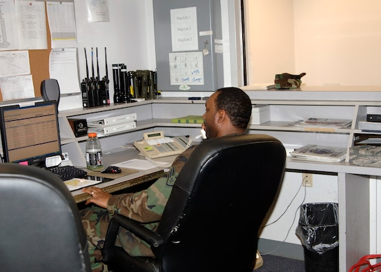 Staff Sgt. Rashsaan Truett, 22nd Logistics Readiness Squadron, receives a phone call for a government vehicle request, Nov. 14. Most requests start with a phone call at the vehicle dispatch office to ensure the required vehicle is available.  (Photo by Senior Airman Anthony Mejia)