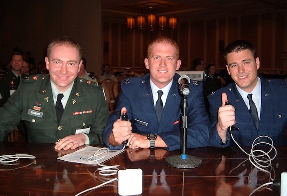 Capt. (Dr.) John Symons, Capt. (Dr.) Ben Morrow, and Capt. (Dr.) Ian Stewart prepare to buzz in their answers during the Jeopardy/Challenge Bowl on Nov. 21.  Dr. Symons, an Army internal medicine resident, and his Air Force teammates won first place during the Air Force competition which was part of the Army/Air Force American College of Physicians annual meeting.  (U.S. Photo by Capt. Eric Flynt)