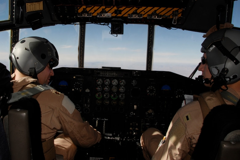 Command Pilot, Maj. Jeff Wong (left) and Co-Pilot, 1st Lt. Jason Christensen (right), with the 109th Airlift Squadron, 133rd Airlift Wing, fly a C-130 Hercules aircraft on their first mission in country to transport top U.S. Army and Afghan military leaders from a military airbase in Herat, Afghanistan to Kabul on Monday, Dec. 1, 2008.