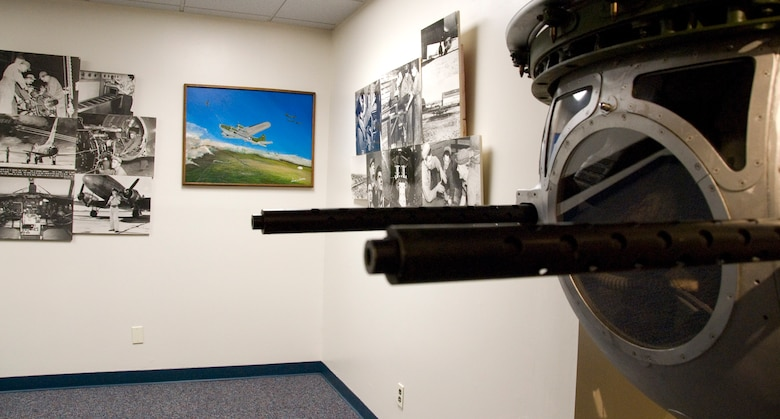 """The """"Gunner's Alley"""" exhibit, complete with the ball turret from a B-17 Flying Fortress, occupies a section in the original museum. When completed, the displays will honor enlisted members who served as aircraft gunners during World War II, the Korean War, the Vietnam War, Desert Storm and the current conflicts. (Air Force photo by Jamie Pitcher)"""