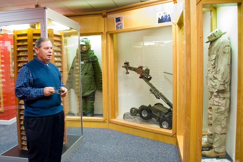 """The explosive ordnance demolition display in the new """"Berlin to Baghdad"""" wing of Enlisted Heritage Hall features a bomb disposal suit, explosives disposal robot and career field uniform. The exhibit will eventually incorporate graphic backgrounds to better illustrate the duties of EOD personnel. (Air Force photo by Jamie Pitcher)"""