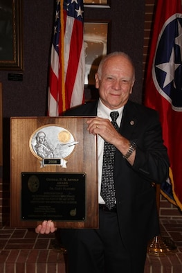 Prof. Gary Flandro of the University of Tennessee Space Institute holds up his General Henry H. H. Arnold Award. (Photo provided)
