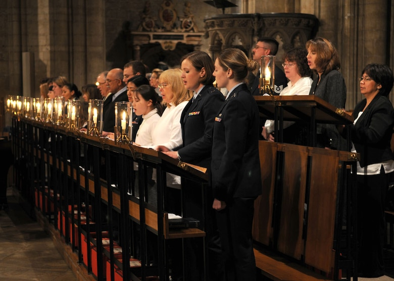 Capt. Meghann Fletcher and Kathleen Pohl, both members of the choir, sing a hymn during the annual Thanksgiving service held at the Ely Cathedral Nov. 26, 2008, in Ely, England. (U.S. Air Force photo by Staff Sgt. Jerry Fleshman)