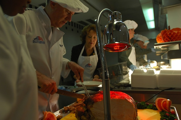 U.S. Air Forces in Europe Commander Gen. Roger Brady carves one of the first slices of turkey kicking off the Thanksgiving celebration at the Rheinland Inn Dining Facility at Ramstein Nov. 27. KMC commanders, chiefs and first sergeants helped serve over 800 people at the dining facilities on Ramstein and Kapaun. (U.S. Air Force photo by Airman 1st Class Kenny Holston)