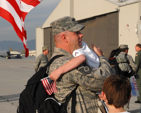 SALT LAKE CITY - Master Sgt. Brent Davis from the 151st Security Forces Squadron, Utah Air National Guard, hugs his children after returning from a six-month deployment to the Kingdom of Saudi Arabia.  Twenty two SFS Airmen arrived back to a crowd of friends and family members on Nov. 22, 2008.  The squadron members were deployed in support of Operation Iraqi Freedom.  U.S. Air Force photo by Staff Sgt. Emily Monson