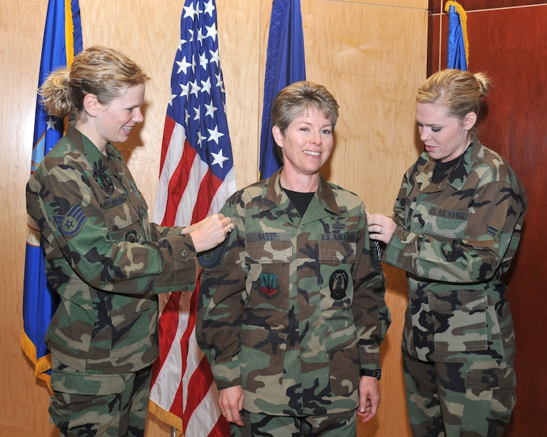 Staff Sergeant Erin B Nielsen and Airman First Class Ainslee E Rager-McIlwaine perform the pinning of her new rank of Chief Master First Sergeant stripes on the mother SMSgt Denise M Rager.  She is the new 151st Wing First Sergeant along with being the first CMS First Sergeant of the Utah Air National Guard.  Salt Lake City, Utah. November 2, 2008