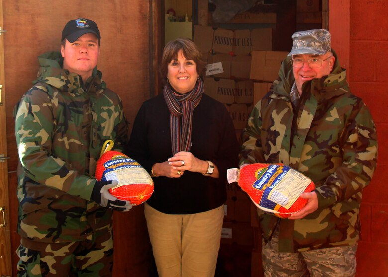 L to R - SSgt Murphy, Gail LaGass, and SMSgt Thompson