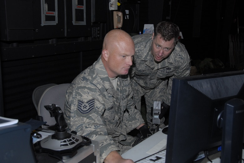 Tech Sgts. Jody Sammons and Jay Ellis manage the computer