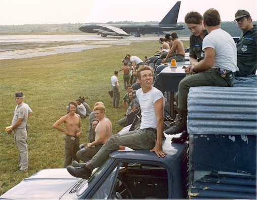Taking a moment out of their exhausting schedules, Airmen from the Consolidated Aircraft Maintenance Wing watch as a wave of B-52s take off en route for targets over North Vietnam. (Courtesy photo)
