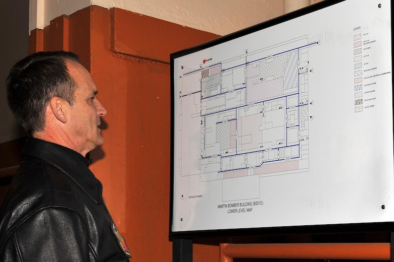 OFFUTT AIR FORCE BASE, Neb. -- Brig. Gen. James Jones, 55th Wing commander studies a map of the Martin Bomber Building during his tour Dec. 4. The building has undergone extensive cleanup efforts since March in order to improve the work environment for many military and civilian members of Team Offutt. Maps like this one are now located in many entrances to aide those trying to navigate this 1.5 million square foot building.   (U.S. Air Force Photo By Charles Hammond)