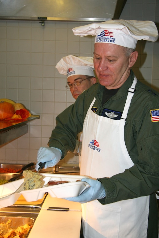Maj. Gen. Ron Ladnier, commander of Seventeenth Air Force, serves up turkey and all the fixin's at the Ramstein Air Base, Germany, dining facility on Thanksgving day. The general joined with other Ramstein senior leaders in serving the troops, a holiday tradition for Air Force commanders. 