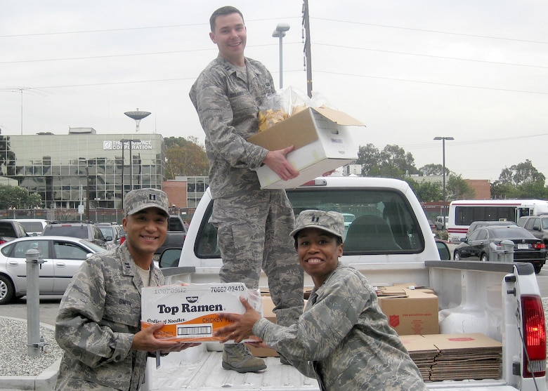 Captains Trey Smith, Dina Marion, and Nicholas Feranec are more than happy to show off the food items collected for the GPSW Thanksgiving Food Drive. (Courtesy photo)