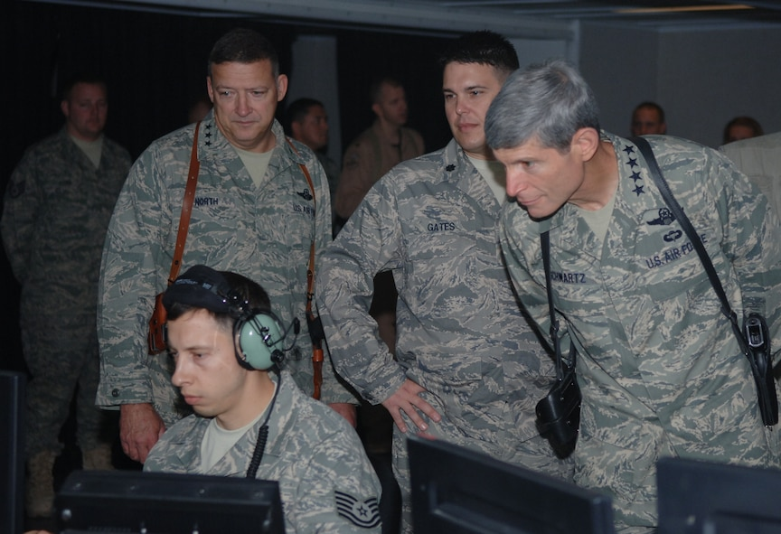 Tech. Sgt. Douglas Lichoff, air surveillance technician, 727 EACS, displays the critical role he plays in the CRC of interpreting radar and IFF codes to identify aircraft in the airspace, as Lt. Gen. Gary North, commander, 9th Air Force, Lt. Col. Bryan Gates, commander, 727 EACS, and Gen. Norton Schwartz, Air Force Chief of Staff look over his shoulder.