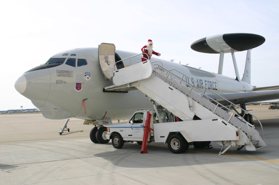 Santa Claus arrives at the 552 ACW Children's Christmas Party on an E-3 Sentry and is greeted by Col. Pat Hoffman, commander, 552 ACW. Photo courtesy of 1Lt Kinder Blacke.