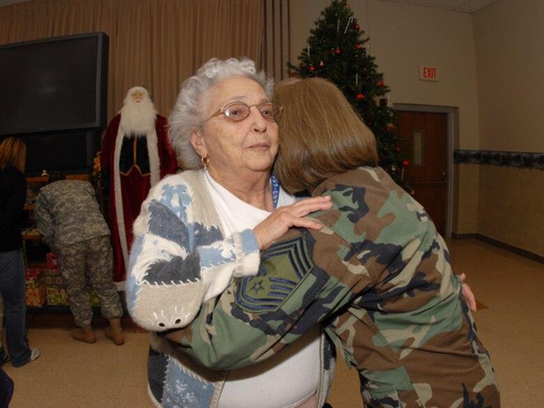 Chief Master Sgt. Paula Johnson, N.D. State Command Chief, hugs a Veteran at the North Dakota Veterans Home in Lisbon, N.D. on December, 19, 2007.