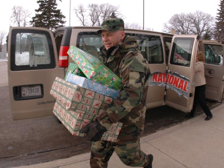 Senior Master Sgt. Paul Tangen, N.D. Air National Guard, helps unload presents for Veterans at the North Dakota Veterans Home in Lisbon, N.D. on December 19, 2007.