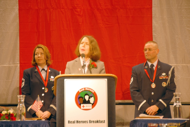 On behalf of the 174th Fighter Wing Base Honor Guard, SMSgt Melinda Haines and TSgt James Jarmacz accepts the Military Hero Award, presented by Ellen Mitchell of Lockheed-Martin at the Red Cross Real Heroes Breakfast, held at the Oncenter Convention Center Complex on Wednesday, December 3, 2008.  The primary mission of the base honor guard is to provide military funeral honors for active duty, retired members, and veterans.  The 174th Fighter Wing Base Honor Guard consists of 52 volunteers from Hancock Field.