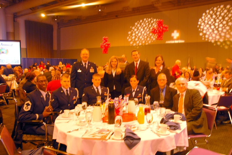 Colonel Kevin W. Bradley, 174th Fighter Wing Commander, poses with members of the 174th Base Honor Guard at a Red Cross Real Heroes Breakfast on Wednesday, December 3, 2008 at the Oncenter Convention Center in Downtown Syracuse, NY.  The honor guard was presented the award for the Military Hero.  The primary mission of the base honor guard is to provide military funeral honors for active duty, retired members, and veterans.  The 174th Fighter Wing Base Honor Guard consists of 52 volunteers from Hancock Field.
