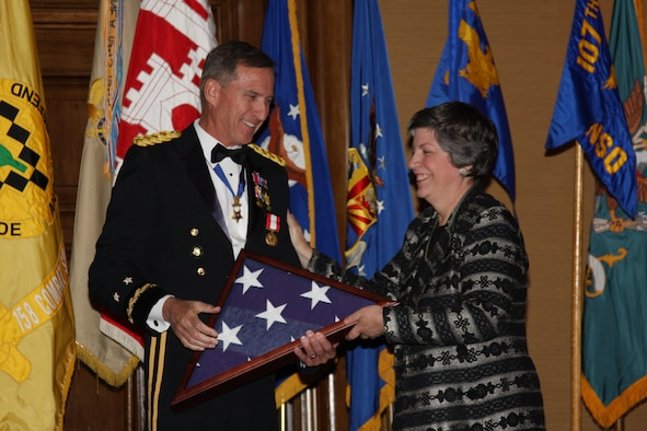 SCOTTSDALE, Ariz. - Maj. Gen. David P. Rataczak, the Adjutant General of Arizona, is presented with a flag that was flown over the 161st Air Refueling Wing by Governor Janet Napolitano during a ceremony honoring Rataczak's retirement and 43 years of military service. More than 400 people attended the gala event that was held at the Scottsdale Resort and Conference Center Dec. 6.  (Army National Guard photo by Sgt. Ed Balaban)