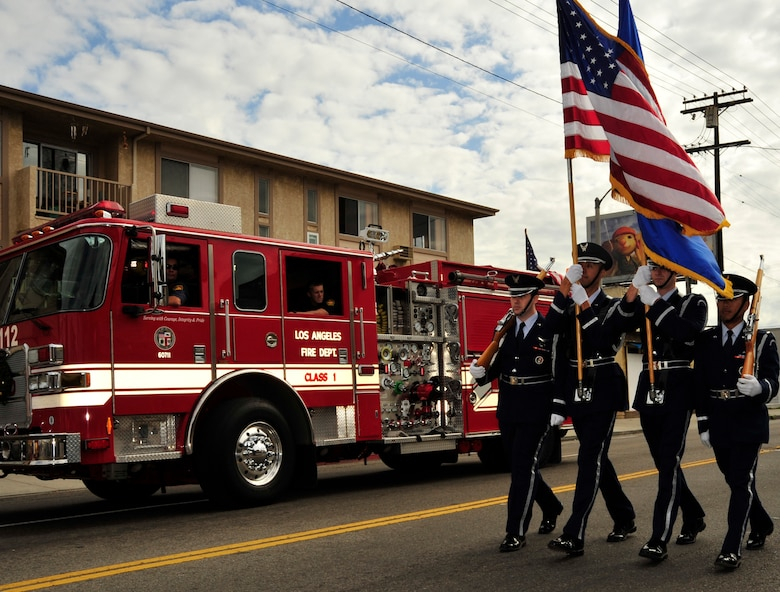 An LAAFB Honor Guard marched in the annual San Pedro Holiday parade, which included local dignitaries, marching bands and community groups. (Photo by Lou Hernadez)