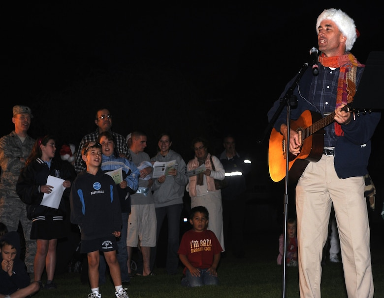 Christmas carols add to the holiday mood at LAAFB's annual tree lighting ceremony on Fort MacArthur, Dec. 2 (Photo by Atiba Copeland)