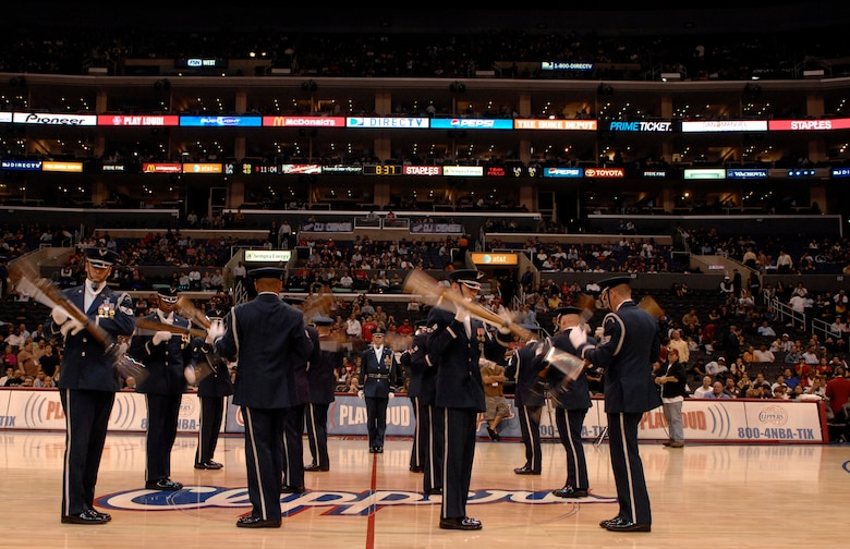 The United States Air Force Honor Guard Drill Team performs Nov. 17 at a Los Angeles Clippers basketball game at the Staples Center in Los Angeles. The Drill Team performed at the game as part of a 23-day temporary duty that started at McChord Air Force Base, Wash. and ended during Los Angeles's Air Force Week. (U.S. Air Force photo by Senior Airmen Tim Chacon)