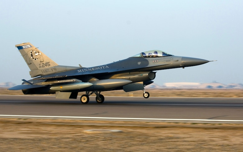 An F-16 Fighting Falcon piloted by Maj. Curt Grayson touches down at Joint Base Balad, Iraq, Dec. 10. Grayson's home unit, the Minnesota Air National Guard's 179th Fighter Squadron, will carry the 332nd Expeditionary Fighter Squadron designation while deployed. Grayson is a native of Esco, Minn. (U.S. Air Force photo/Tech. Sgt. Erik Gudmundson)