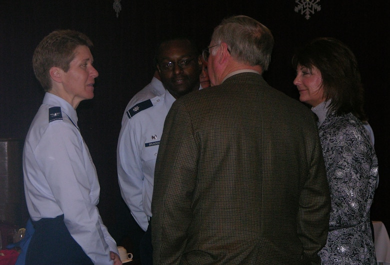 Col. Pat Hoffman, commander, 552 ACW, and Lieutenant Col. Lawrence Brundidge, commander, 960th Airborne Air Control Squadron, talk with the Honorary Commanders as they arrive to the quarterly luncheon December 8. Photo courtesy of Tech. Sgt Rachel Moore.