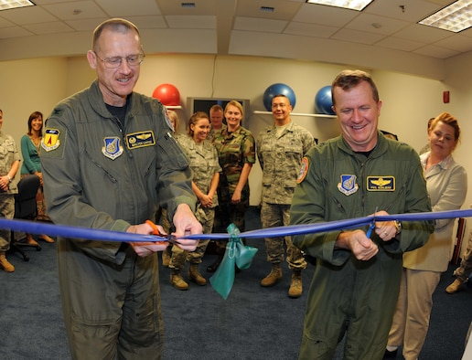 ANDERSEN AIR FORCE BASE, Guam - Col. Walter Cayce (left), 36th Medical Group commander, helps Brig. Gen. Phil Ruhlman (right), 36th Wing commander, mark the opening of Andersen's new physical therapy clinic at a ribbon-cutting ceremony Dec. 11.  The ceremony was held at the Health and Wellness Center, which houses the new facility.  (U.S. Air Force photo by Senior Airman Jonathan Hart)
