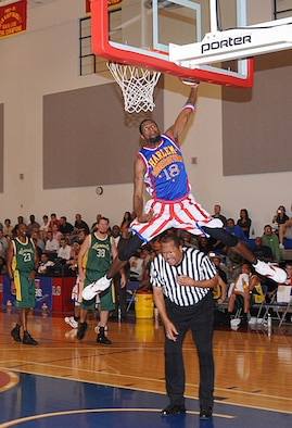 "ANDERSEN AIR FORCE BASE, Guam - Jermaine ""Hi Rise"" Brown leap frogs over the referee to slam dunk the ball here Dec. 15.  The Harlem Globetrotters entertained Andersen's Airmen and their families on Monday night during a game played against the Washington Generals.   (U.S. Air Force photo by Staff Sgt. Jamie Lessard)"