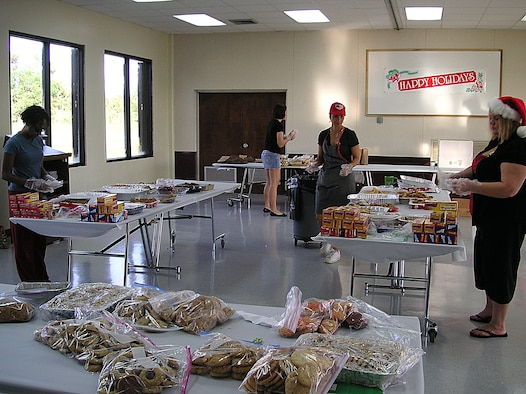 ANDERSEN AIR FORCE BASE, Guam -- Volunteers at this year's Cookie Caper event, held at the Chapel 2 Annex Dec. 15, worked at different stations to ensure efficiency throughout the event. Volunteers decorated bags, cut ribbon, made cards and posters, assembled cookie bags and delivered cookie trays across the base. (Courtesy photo)