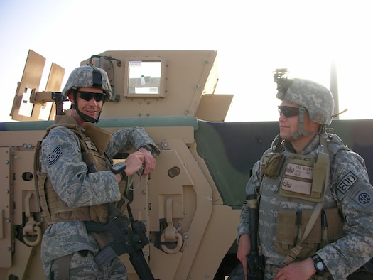 Tech. Sgt. John Carrol (left) and Senior Airman Bryan Berky, 755th Expeditionary Mission Support Group, Explosive Ordinance Disposal Company Bravo, take a break during an improvised explosive device detection operation in the Nimruz Province, Afghanistan, July 4, 2007.  Ellsworth has more than 400 total military members deployed to various locations worldwide in support of the Global War on Terror. (U.S. Air Force photo/courtesy photo)