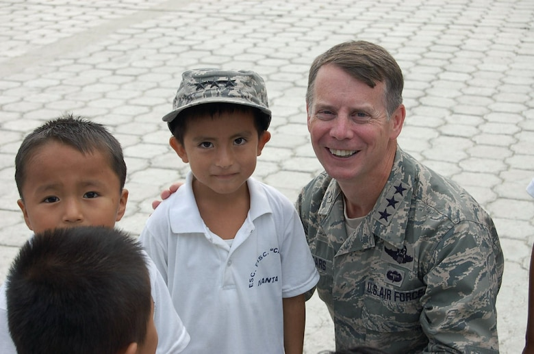 Lt. Gen. Glenn F. Spears gets acquainted with students from the San Juan Elementary School Dec. 10 in San Juan, Ecuador. The general presented a donation certificate for $6,000 in school supplies to the school's director in front of the nearly 330 children enrolled. General Spears is the Southern Command deputy commander. (U.S. Air Force photo/Tech. Sgt. Matthew McGovern)
