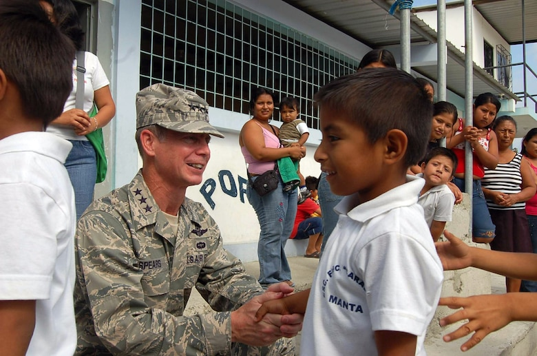 Lt. Gen. Glenn F. Spears meets students after he presented the Southern Command's Humanitarian Assistance Program donation of school supplies Dec. 10 at the San Juan Elementary School in Ecuador. General Spears is the Southern Command deputy commander. (U.S. Air Force photo/Tech. Sgt. Matthew McGovern)
