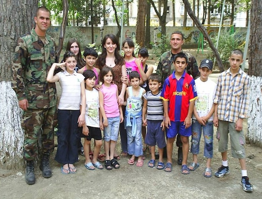 Staff Sergeant's Paul Corcoran and Brian Leach, from Kentucky's 123rd Contingency Response Group, pose for a photo while visiting an orphanage near Tblisi, Georgia, in September. The two sergeants deployed there with the 86th Contingency Response Group on a humanitarian mission following the Russian invasion into the area. (Photo courtesy of the 86th Contingency Response Group)