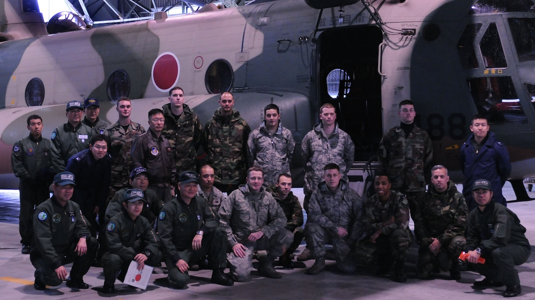 YOKOTA AIR BASE, Japan- Members of Yokota's 374th Maintenance Group and the Japanese Air Self Defense Force pose for a group photo in front of a CH-47J helicopter Dec. 17 at Iruma Air Base. Members of the 374th Airlift Wing and Japanese Air Self Defense Force participate in these bilateral events once a quarter to build understanding between their cultures. (U.S. Air Force photo by Airman Devin Doskey)