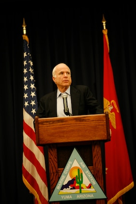 Arizona Sen. John McCain speaks to members of the media at a press conference Dec. 17, 2009, during his visit to the Marine Corps Air Station in Yuma, Ariz., to speak to Marine officials on border-related issues affecting military training in the area. McCain expressed the need to increase border facilities to move people, goods and services more rapidly across the United States-Mexico border, because Arizona is dependant on the cross-border trade. He also addressed his concern for the high level of violence in Mexico near the border. (Photo by Cpl. Laura A. Mapes)