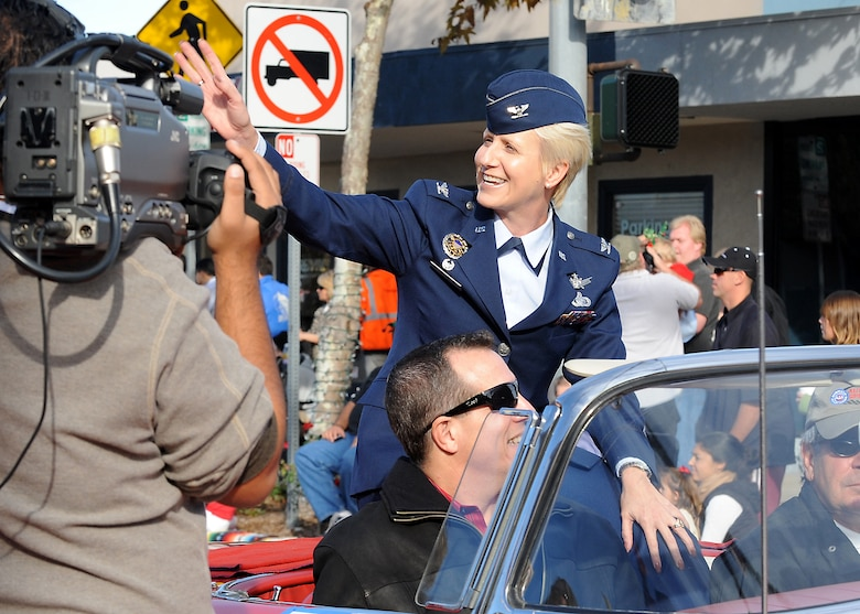 Col. Anita Latin, 61st Air Base Wing commander, rides in a vintage 1957 Thunderbird in the 45th Annual El Segundo Holiday Parade, Dec. 14. The Los Angeles Air Force Base Honor Guard also represented the base in the annual event, which included local dignitaries, marching bands, and community groups. (Photo by Joe Juarez)