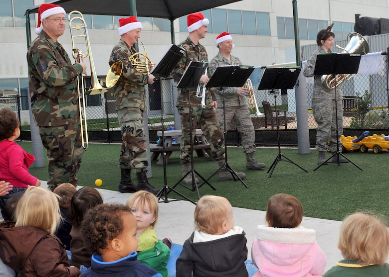 Members of the Travis Brass Quintet, a component of the Band of the Golden West, perform holiday music for the children at the Child Development Center on Los Angeles AFB during their tour, Dec. 16. (Photo by Atiba Copeland)