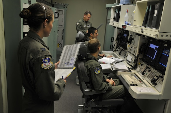 Missileers train in the Missile Procedures Trainer while two 341st Operations Group evaluators look on. (U.S. Air Force Photo/John Turner)