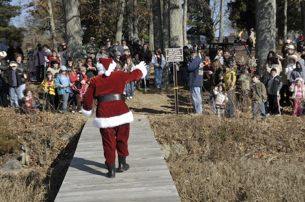 Santa waves to more than 500 children at the end of the dock who attended the annual Children's Christmas Party Dec. 7. (photo by Rick Goodfriend)